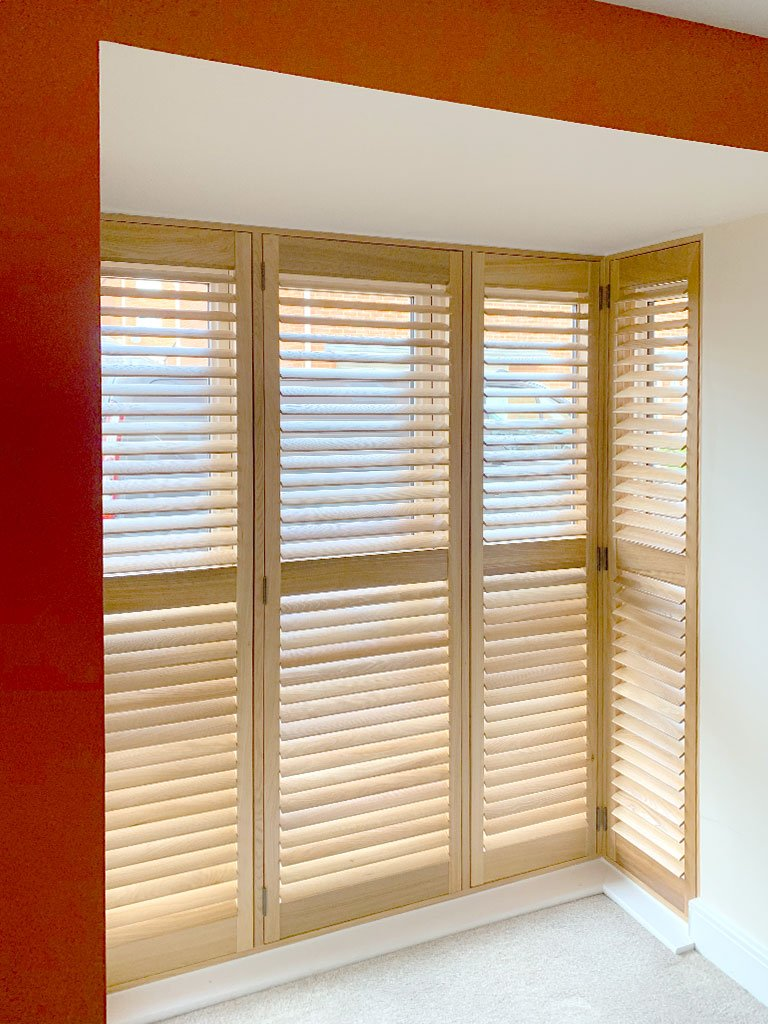 Window shutters with beautiful wood colours to compliment the bright modern interior design.