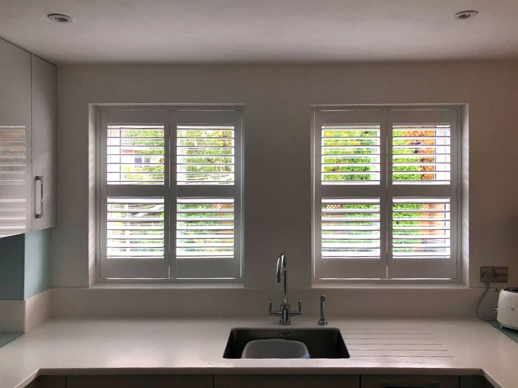 Window shutters for a kitchen help cool the room temperature when the sun is shining.