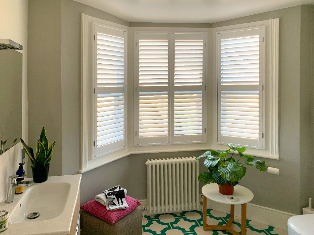 White shutters are perfect for bathrooms and encourage modern colour matching.